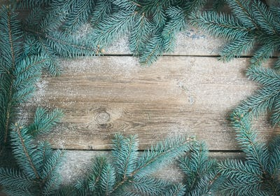 Christmas (New Year) theme background: a frame of fur-tree branc