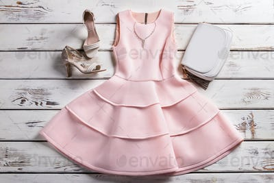 Dress with footwear and jewelry.