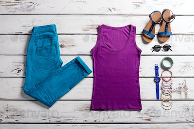 Colorful clothes on wooden background.