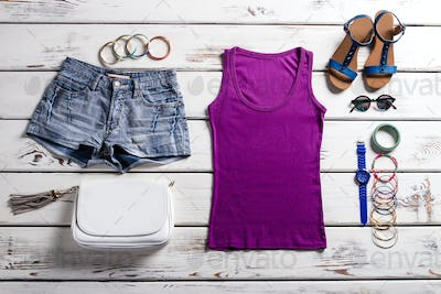 Woman's purple top and shorts.