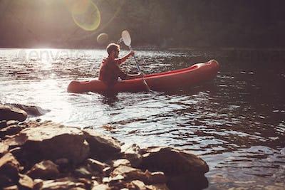 Young man kayaking in a lake