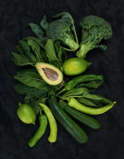 Raw green vegetables set. Broccoli, avocado, pepper, spinach, zucchini, lime