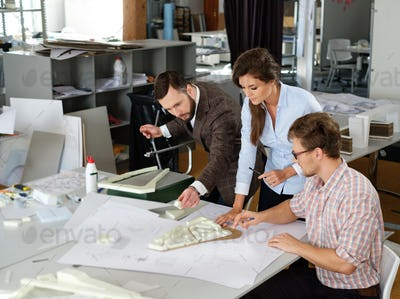 Confident team of engineers working together in a architect stud