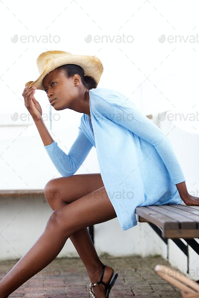 African female fashion model with hat