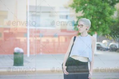 Knee figure of young beautiful thin woman designer view behind a