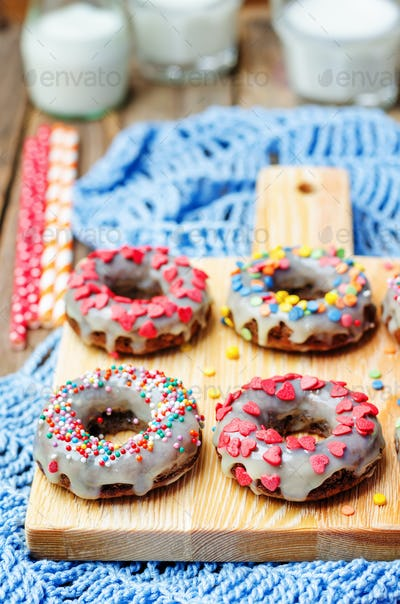 banana Donuts with icing and colorful sprinkles