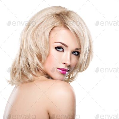 Portrait of  beautiful woman with blond  hair.  face of fashion