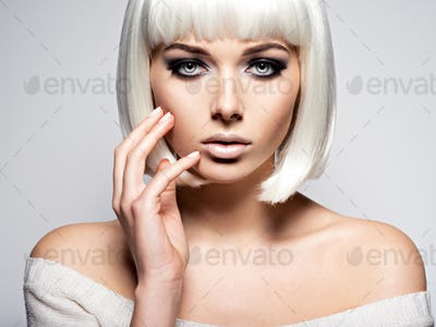 Woman's face with  fashion black makeup of eye and long black ey