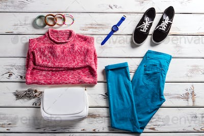 Lady's outfit with pink pullover.
