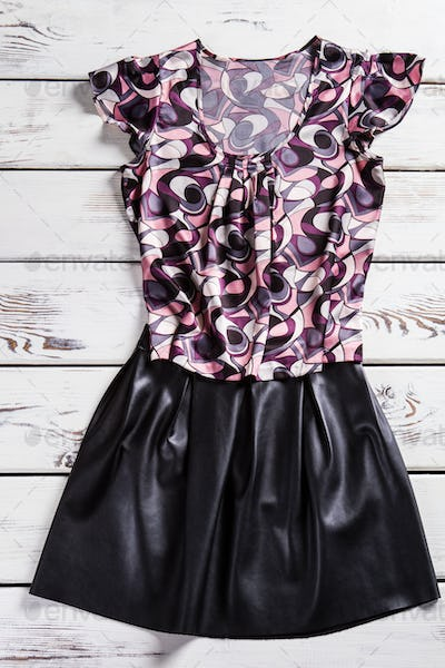 Lady's u-neck t-shirt and skirt.