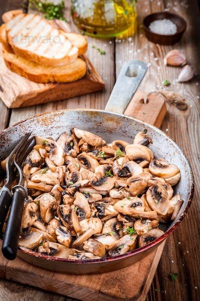 roasted mushrooms in a  pan