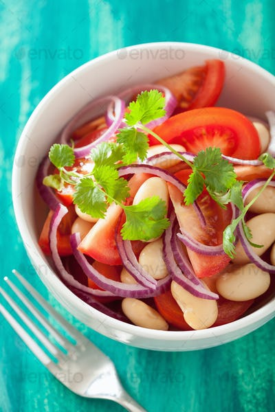 healthy tomato salad with white beans onion coriander