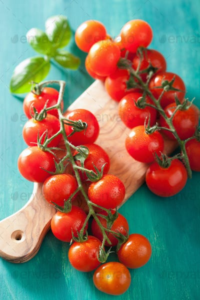 cherry tomatoes over turquoise background