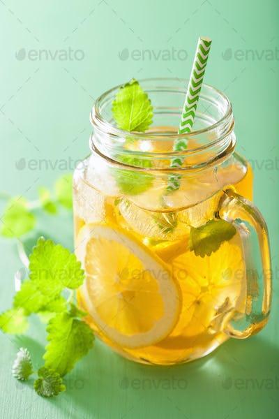 ice tea with lemon and melissa in mason jars