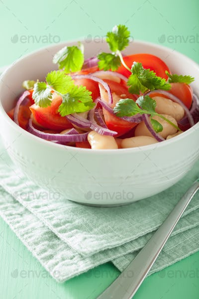 healthy tomato salad with white beans onion cilantro
