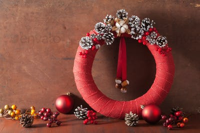 red christmas wreath on wooden background
