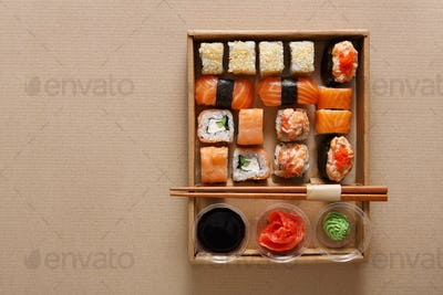 Set of sushi rolls at carton texture background