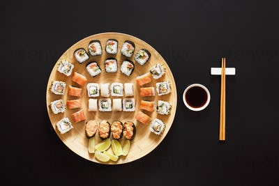 Set of sushi maki and rolls at black background