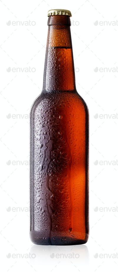 Brown cold beer bottle with drops