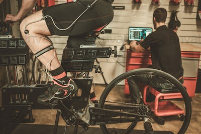 Professional cyclist being tested on body geometry simulator in