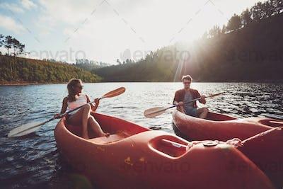Young couple kayaking on a lake together