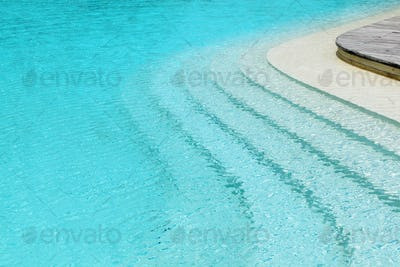 curved steps in swimming pool at the resort