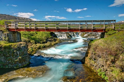Bruarfoss waterfall with footbridge