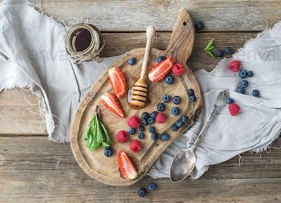 Blueberries, raspberries, strawberries, honey and fresh mint