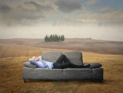 Businessman lying on the sofa