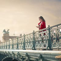 Woman texting on a bridge