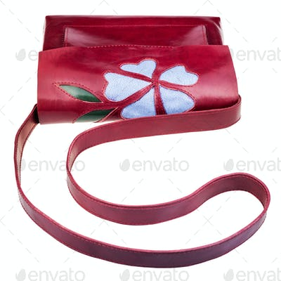 dark cherry color handbag decorated by flower
