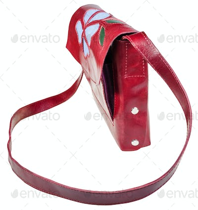 side view of cherry color handbag with flower
