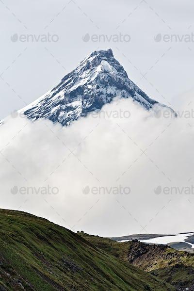 Mountain Landscape of Kamchatka: Kamen Volcano in Clouds