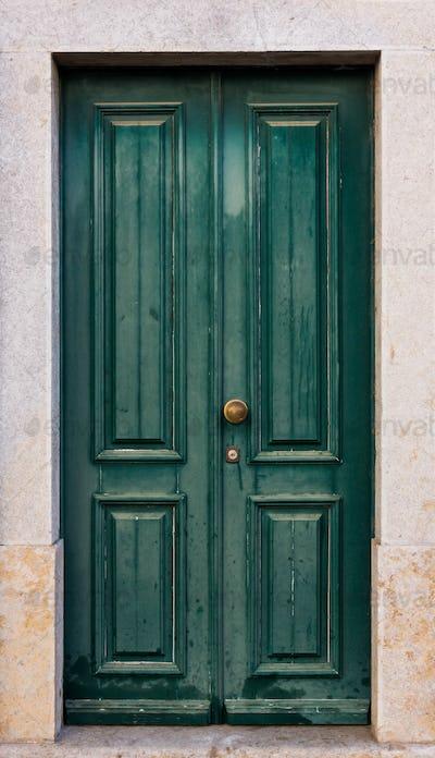Green door. entrance door in front of residential house.