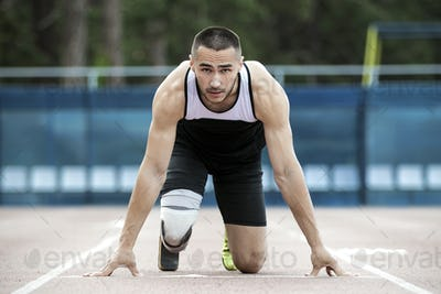 amputee athlete preparing to start