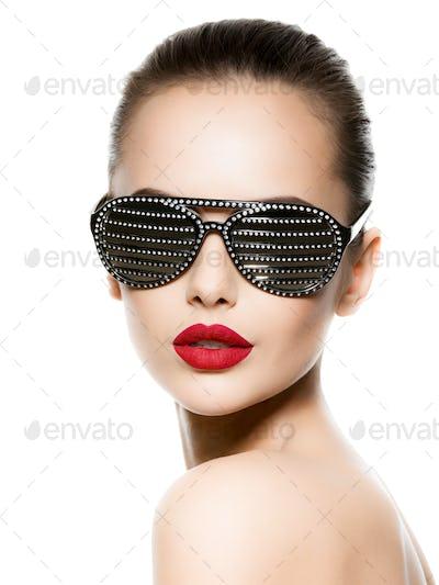 Fashion portrait of  woman wearing black sunglasses with diamond