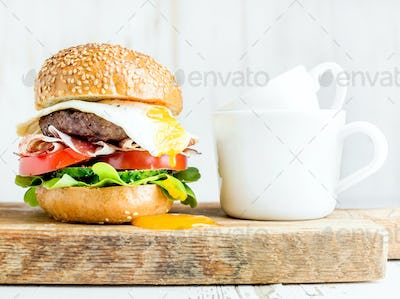 Breakfast set. Homemade beef burger with fried egg