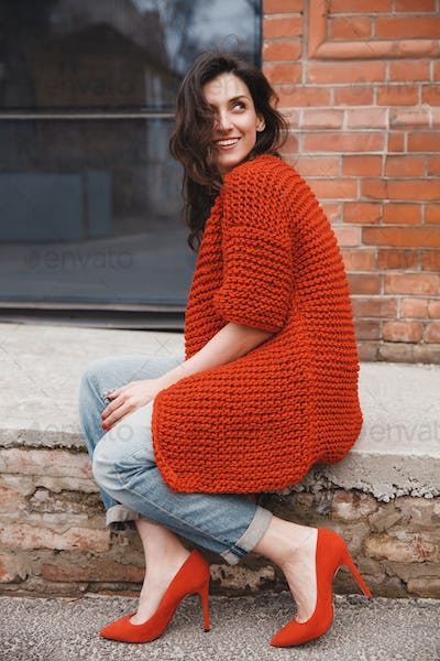 Woman wearing knitted colorful coat outdoor