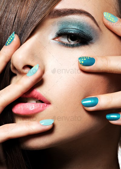 Beautiul fashion woman with turquoise make-up and nails