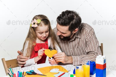 The daughter and father carving out paper applications