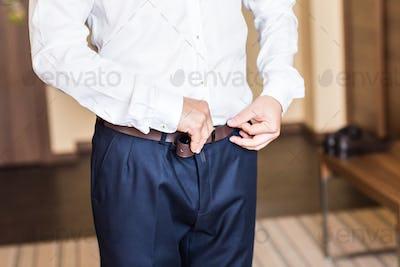 Man with  belt close-up