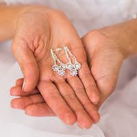 earrings on a female hand