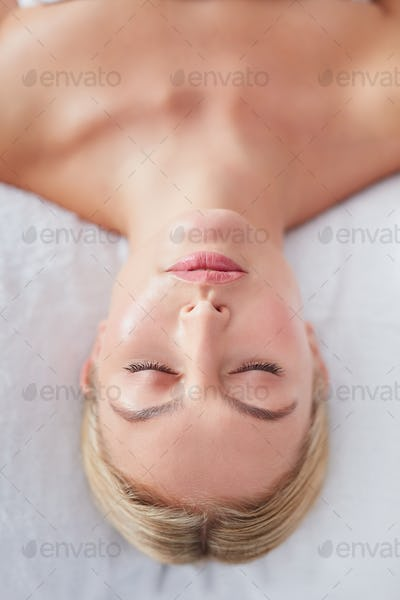 Beautiful woman on a massage table at dayspa