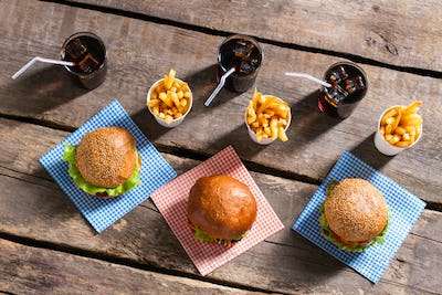 Burgers with fries and cola.