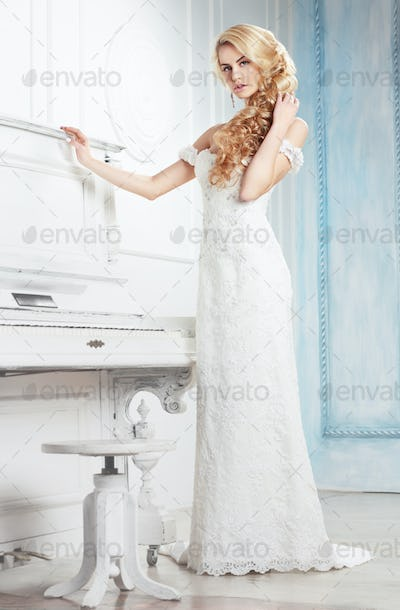 The bride in a white dress.