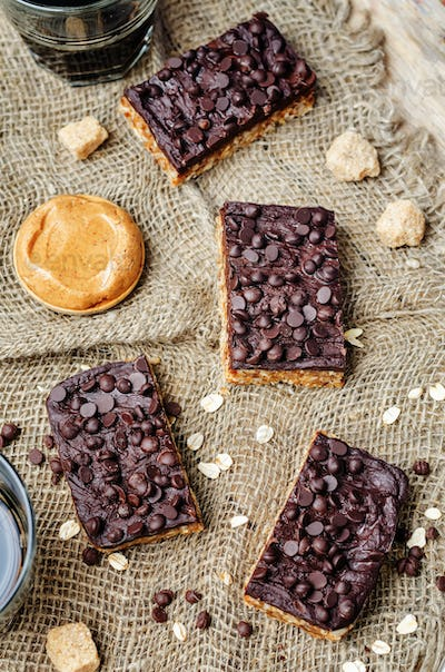raw vegan dates oats peanut butter bars with chocolate frosting