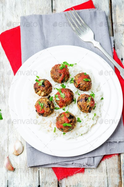 Eggplant white beans vegan meatballs with tomato sauce and rice