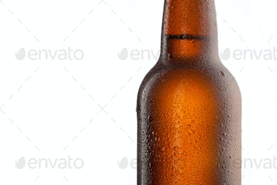 Beer bottle with water drops and frost isolated on white