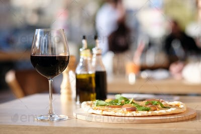 Pizza and red wine in restaurant