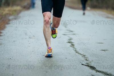 closeup feet of young runner men